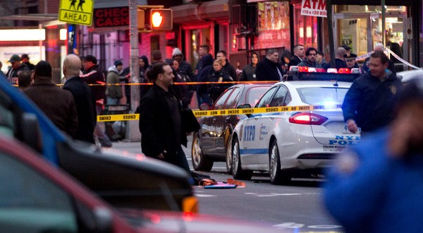 Two Police Officers Are Fatally Shot in Brooklyn; Suspect Is Also Dead