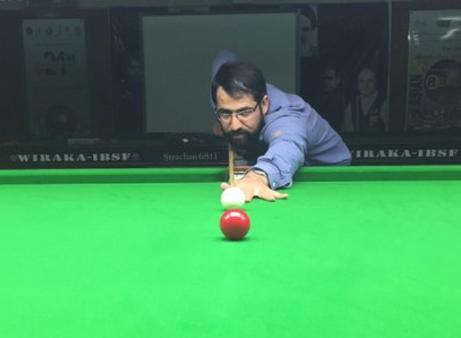 A mullah playing Cue sports & Bowling