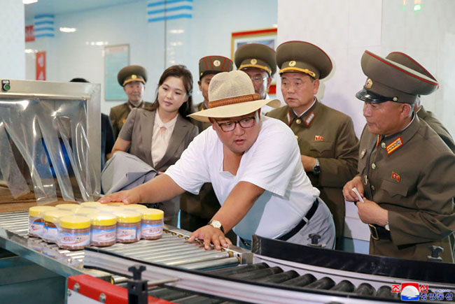Kim Jong-Un strips down to undershirt with wife Ri Sol-ju in heatwave