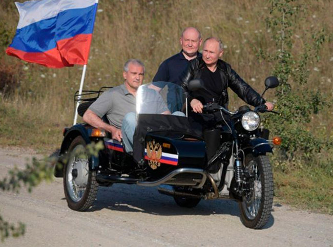 Putin rides Ural as thousands protest